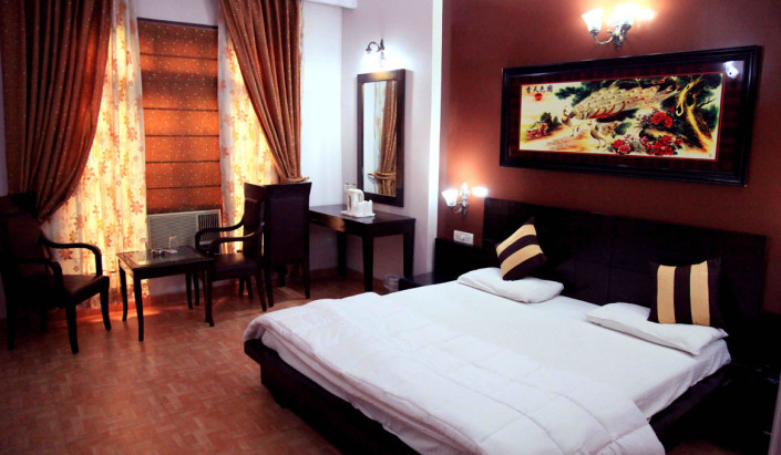 Bedroom of Hotel Mid Town New Delhi